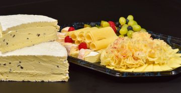 Truffle Brie from world class chef Robert Speth and cheese platter with delicacies